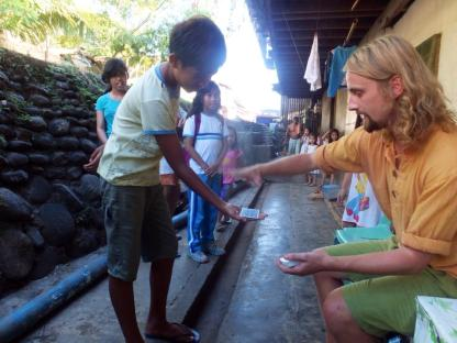 Performing for villagers in the Philippines